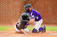 High Point Panthers catcher Spencer Angelis #11 puts the tag on George Piccirilli #27 of the VMI Keydets at Willard Stadium on March 31, 2012 in High Point, North Carolina.  The Panthers defeated the Keydets 2-0.  (Brian Westerholt/Four Seam Images)