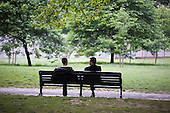 Two men on a bench in Green Park.