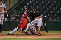 AZL Angels relief pitcher Cristia Reyes (33) shows the ball after applying the tag to Felix Fernandez (9) in front of home plate umpire Shin Koishizawa during an Arizona League game against the AZL Indians 2 at Tempe Diablo Stadium on June 30, 2018 in Tempe, Arizona. The AZL Indians 2 defeated the AZL Angels by a score of 13-8. (Zachary Lucy/Four Seam Images)