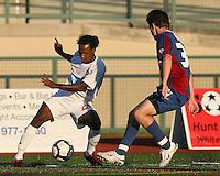 Korey Veeder of Crystal Palace Baltimore blocks Gregory Richardson #20 of the Carolina Railhawks during an NASL match at Paul Angelo Russo Stadium in Towson, Maryland on September 18 2010. Carolina won 4-2.