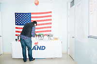 People gather near the food at the campaign headquarters of Kentucky senator and Republican presidential candidate Rand Paul during a celebration at his campaign headquarters in Manchester, New Hampshire.