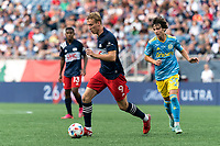 FOXBOROUGH, MA - AUGUST 8: Adam Buksa #9 of New England Revolution dribbles during a game between Philadelphia Union and New England Revolution at Gillette Stadium on August 8, 2021 in Foxborough, Massachusetts.