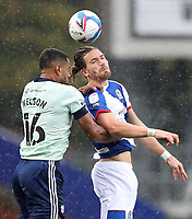 3rd October 2020; Ewood Park, Blackburn, Lancashire, England; English Football League Championship Football, Blackburn Rovers versus Cardiff City; Curtis Nelson of Cardiff City and Sam Gallagher of Blackburn Rovers compete for the header