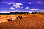 Plowing in the Palouse Country of Washington State, known as the heartland of wheat farming it is also a majestically scenic area well known for its rolling landscapes.