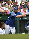 Chicago Cubs coaches during a game against the Miami Marlins on May 9, 2018 at Wrigley Field in Chicago, IL. The Cubs beat the Marlins 13-4.