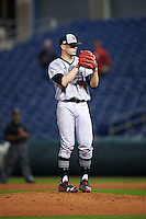 Maryland Terrapins relief pitcher Hunter Parsons (17) gets ready to deliver a pitch during a game against the Louisville Cardinals on February 18, 2017 at Spectrum Field in Clearwater, Florida.  Louisville defeated Maryland 10-7.  (Mike Janes/Four Seam Images)