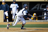Ryan Nelson (8) of the Quinnipiac Bobcats follows through on his swing against the Radford Highlanders at David F. Couch Ballpark on March 4, 2017 in Winston-Salem, North Carolina. The Highlanders defeated the Bobcats 4-0. (Brian Westerholt/Four Seam Images)