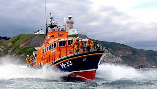 Action stations. The Howth Lifeboat at full power off the Baily Lighthouse