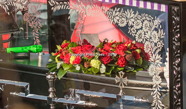 """The horse drawn funeral cortege of the late Prodigy singer Keith Flint makes its way through the packed streets of Bocking,  Braintree, Essex today on route to  St Marys Church. A green microphone and note placed on a wreath of flowers on top of the coffin reads """" To a son and brother who is dearly loved and sadly missed. Lots of love Mum, Dad…."""""""