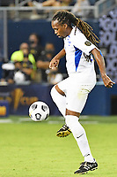 KANSAS CITY, KS - JULY 15: Dondon Gerald #4 of Martinique with the ball during a game between Martinique and USMNT at Children's Mercy Park on July 15, 2021 in Kansas City, Kansas.