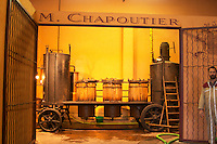 Distillation of marc and fine from wine fermentation residues at M Chapoutier using an old mobile pot still Domaine M Chapoutier, Tain l'Hermitage, Drome Drôme, France Europe