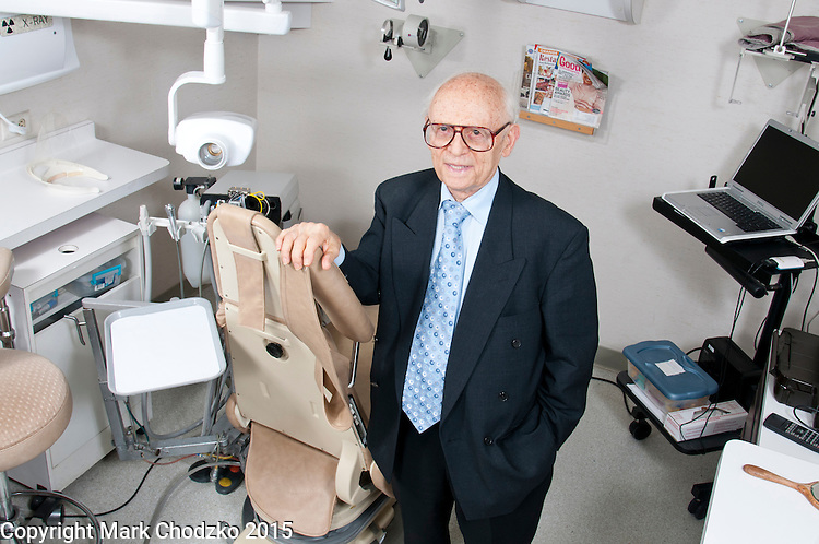 91 year old practicing dentist, Dr. Jacob Eisenbach in his office.