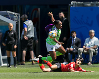 GRENOBLE, FRANCE - JUNE 12: Francisca Ordega #17 of the Nigerian National Team tackled by Soyun Ji #10 of the Korean National Team during a game between Korea Republic and Nigeria at Stade des Alpes on June 12, 2019 in Grenoble, France.