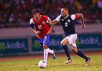 SAN JOSE, COSTA RICA - September 06, 2013: Clint Dempsey (8) of the USA MNT races away from Yeltsin Tejeda (17) of the Costa Rica MNT during a 2014 World Cup qualifying match at the National Stadium in San Jose on September 6. USA lost 3-1.