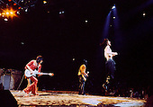 """Chicago, Illinois<br /> July 23, 1975<br /> USA<br /> <br /> Lead singer Mick Jagger, with guitarists Keith Richards (center) and Ronnie Wood (L) of the Rolling Stones performs live at Chicago Stadium during the band's """"Rolling Stones Tour of the Americas '75"""".<br /> <br /> This was the Stones first tour with new guitarist Ronnie Wood, after Mick Taylor left the band. The Stones, with their usual act freshly aided by theatrical stage props  including a giant inflatable phallus (nicknamed 'Tired Grandfather' by the band, since it sometimes malfunctioned) and, at the Chicago shows, an unfolding lotus flower-shaped stage that Charlie Watts had conceived.<br /> <br /> The band was composed of  Mick Jagger - vocals, guitar, harmonica, Keith Richards - guitar, vocals, Bill Wyman - bass guitar, and Charlie Watts - drums, percussion. <br /> <br /> Additional musicians included: Ronnie Wood - guitar, backing vocals, Ian Stewart - piano, Billy Preston - keyboards, vocals and Ollie Brown - percussion."""