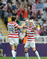 Newcastle, England - Friday, August 3, 2012: The USA women defeated New Zealand 2-0 in the quarterfinal round of the 2012 Olympics at St. James Park. Abby Wambach celebrates her goal with Megan Rapinoe.