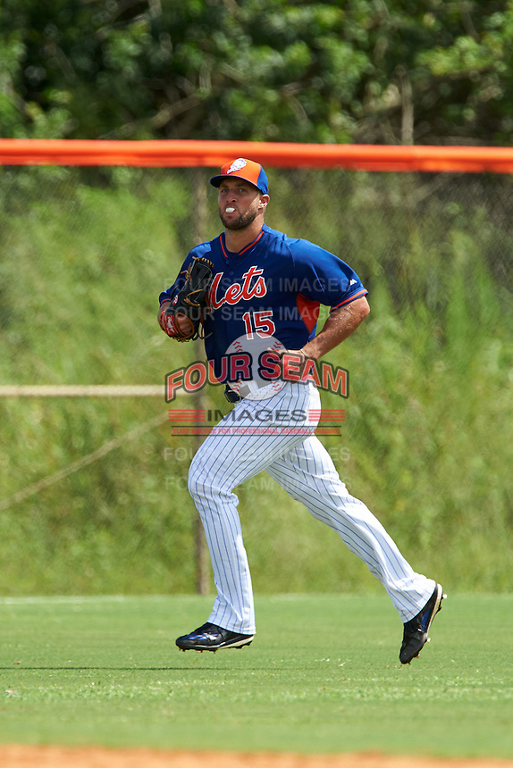 New York Mets outfielder Tim Tebow (15) blows a bubble while jogging to the dugout during an Instructional League game against the Miami Marlins on September 29, 2016 at Port St. Lucie Training Complex in Port St. Lucie, Florida.  (Mike Janes/Four Seam Images)
