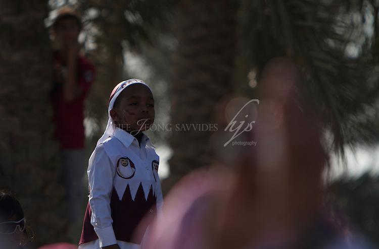 A little boy all dressed up for the National Day, Doha, Qatar | Dec 10