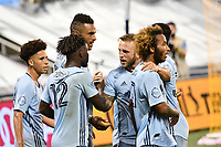 KANSAS CITY, KS - SEPTEMBER 02: Sporting KC players celebrate their equalizing goal during a game between FC Dallas and Sporting Kansas City at Children's Mercy Park on September 02, 2020 in Kansas City, Kansas.