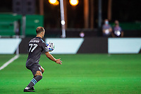 LAKE BUENA VISTA, FL - AUGUST 06: Chase Gasper #77 of Minnesota United FC receives a pass during a game between Orlando City SC and Minnesota United FC at ESPN Wide World of Sports on August 06, 2020 in Lake Buena Vista, Florida.