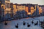 Gondoliers on the Grand Canal, sunset, Venice, Italy,