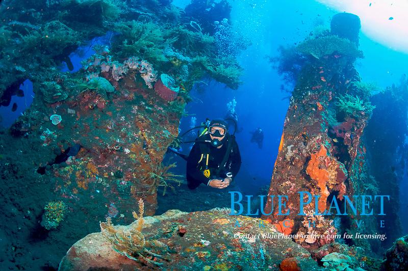 Divers explore the World War II Liberty Wreck off of Tulamben, Bali, Indonesia, Indian Ocean