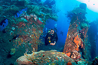 Divers explore the World War II Liberty Wreck off of Tulamben, Bali, Indonesia, Indian Ocean