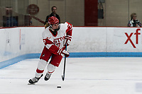 BOSTON, MA - FEBRUARY 16: Jesse Compher #7 of Boston University looks to pass during a game between University of New Hampshire and Boston University at Walter Brown Arena on February 16, 2020 in Boston, Massachusetts.