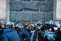 """Figter of special force """"Berkut"""" prepare for use of tear gas. Kiev. Ukraine Thousands of people are continuing to express their support to european integration and protesting against decision of Ukrainian government to refuse signing of association with EU in Vilnius."""