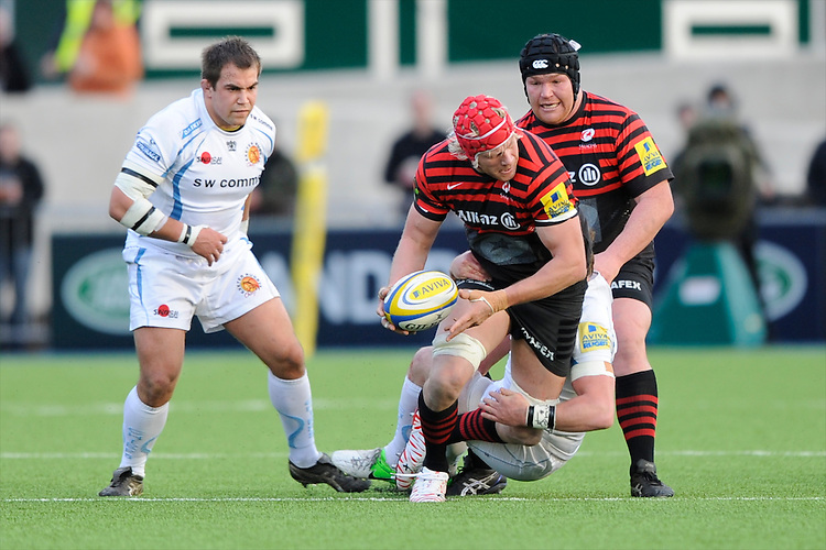 20130216 Copyright onEdition 2013©.Free for editorial use image, please credit: onEdition..Mouritz Botha of Saracens looks for support as he is tackled during the Premiership Rugby match between Saracens and Exeter Chiefs at Allianz Park on Saturday 16th February 2013 (Photo by Rob Munro)..For press contacts contact: Sam Feasey at brandRapport on M: +44 (0)7717 757114 E: SFeasey@brand-rapport.com..If you require a higher resolution image or you have any other onEdition photographic enquiries, please contact onEdition on 0845 900 2 900 or email info@onEdition.com.This image is copyright onEdition 2013©..This image has been supplied by onEdition and must be credited onEdition. The author is asserting his full Moral rights in relation to the publication of this image. Rights for onward transmission of any image or file is not granted or implied. Changing or deleting Copyright information is illegal as specified in the Copyright, Design and Patents Act 1988. If you are in any way unsure of your right to publish this image please contact onEdition on 0845 900 2 900 or email info@onEdition.com
