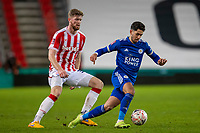 9th January 2021; Bet365 Stadium, Stoke, Staffordshire, England; English FA Cup Football, Carabao Cup, Stoke City versus Leicester City; Ayoze Perez of Leicester City under pressure from Nathan Collins of Stoke City