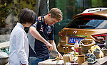 Formula One Triple World Champion Sebastian Vettel (R) slices fresh seasonal bamboo for traditional Chinese soup with chef Tzu-i Chuang Mullinax at the Yongfoo Elite Chinese restaurant during his day with Infiniti ahead of the Chinese Grand Prix on 10 April 2013 in Shanghai, China. Photo by Victor Fraile / The Power of Sport Images