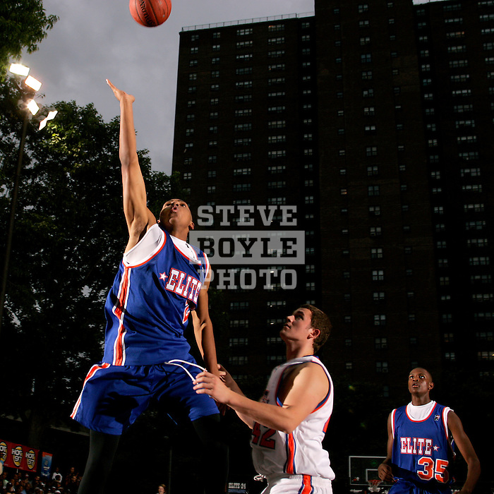 Gary Johnson (23) goes up for a layup in front of Kevin Love (42) during the Elite 24 Hoops Classic game on September 1, 2006 held at Rucker Park in New York, New York.  The game brought together the top 24 high school basketball players in the country regardless of class or sneaker affiliation.