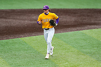 LSU Tigers right fielder Dylan Crews (3) jogs off the field between innings of the game against the Tennessee Volunteers on Robert M. Lindsay Field at Lindsey Nelson Stadium on March 28, 2021, in Knoxville, Tennessee. (Danny Parker/Four Seam Images)