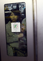 Passengers squeezed onto full trains are pushed against the glass during morning rush hour, Shinjuku, Tokyo. With up to 4 million passengers passing through it every day, Shinjuku station, Tokyo, Japan, is the busiest train station in the world. The station was used by an average of 3.64 million people per day.  That's 1.3 billion a year.  Or a fifth of humanity. Shinjuku has 36 platforms, and connects 12 different subway and railway lines.  Morning rush hour is pandemonium with all trains 200% full. <br /> <br /> Photo by Richard jones / sinopix
