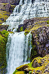 Person taking a picture on the upper lever of the Iceland waterfall