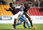 St Johnstone v Hearts…23.12.17…  McDiarmid Park…  SPFL<br />David Wotherspoon fends off Prince Buaben and Christophe Berra<br />Picture by Graeme Hart. <br />Copyright Perthshire Picture Agency<br />Tel: 01738 623350  Mobile: 07990 594431