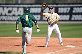 Central Florida Knights first baseman James Vasquez (13) takes a throw to force out Vincent Citro (6) during a game against the Siena Saints at Jay Bergman Field on February 16, 2014 in Orlando, Florida.  UCF defeated Siena 9-6.  (Copyright Mike Janes Photography)