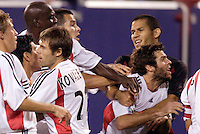 D.C. United's Ben Olsen is restrained by teammates and the MetroStars' Craig Ziadie during the second of two scuffles that marred first half play. D.C. United defeated the MetroStars 1 to 0 in regular season MLS action on Saturday October 2, 2004 at Giant's Stadium, East Rutherford, NJ..
