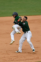 Third baseman Tanner Nishioka (30) of the Greenville Drive is lifted off the ground by Victor Acosta after getting a walk-off hit to win a game against the Asheville Tourists, 7-6, on Sunday, June 3, 2018, at Fluor Field at the West End in Greenville, South Carolina. (Tom Priddy/Four Seam Images)