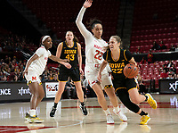 COLLEGE PARK, MD - FEBRUARY 13: Kathleen Doyle #22 of Iowa pushes her way past Blair Watson #22 of Maryland during a game between Iowa and Maryland at Xfinity Center on February 13, 2020 in College Park, Maryland.
