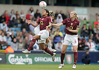 Arsenal vs Leeds United - Womens FA Cup Final at Millwall Football Club - 01/05/06 - Arsenal's Mary Phillip (left) beats Karen Walker in the air, watched by Faye White (right)- (Gavin Ellis 2006)