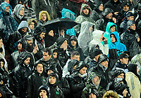 Pictured: PAOK supporters in Toumba Stadium in Thessaloniki, Greece. Sunday 25 February 2018<br /> Re: Sunday's Greek Super League derby between PAOK Thessaloniki and Olympiakos was called off after Olympiakos' manager Oscar Garcia was struck in the face by an object believed to be a till machine paper roll, thrown by a spectator minutes before kick-off.<br /> Garcia left Toumba Stadium for a local hospital to seek treatment for a bloodied lip.<br /> The incident prompted the Olympiakos team to leave the pitch in protest before riots erupted outside the ground.<br /> Angry PAOK fans leaving the stadium then clashed with police who used tear gas to quell the violence.