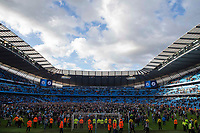 Manchester City fans invade the pitch after the Premier League match between Manchester City and Swansea City at the Etihad Stadium, Manchester, England, UK. Sunday 22 April 2018