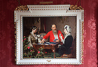 A portrait of Thomas Merthyr Guest playing cards with his wife, Theodora, and her mother, the Marchioness of Westminster