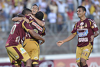 IBAGUÉ -COLOMBIA, 20-06-2013. Jugadores de Deportes Tolima celebran un gol en contra de Deportivo Pasto durante partido de los cuadrangulares finales, fecha 2, de la Liga Postobón 2013-1 jugado en el estadio Manuel Murillo Toro de la ciudad de Ibagué./ Deportes Tolima players celebrate a goal against Deportivo Pasto during match of the final quadrangular 2th date of Postobon  League 2013-1 at Manuel Murillo Toro stadium in Ibagué city. Photo: VizzorImage/STR