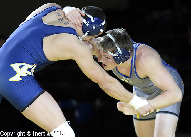 SIOUX FALLS, SD: DECEMBER 8: Ben Schwery from South Dakota State battles with Sean Derry from Augustana in their 184 pound match Sunday afternoon at the Sanford Pentagon. (photo by Dave Eggen/Inertia)