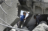 "A Palestinian boy play over debris at the site of a destroyed metal workshop targeted by an Israeli air strike in Gaza City, early 25 May 2007.""photo by Fady Adwan"""