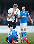 Kevin Kyle chews on the ball as he gets booked for shoving Dean Shiels