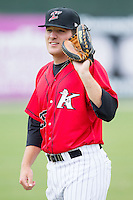 Jeremy Dowdy (25) of the Kannapolis Intimidators warms up in the outfield prior to the game against the Greenville Drive at CMC-Northeast Stadium on April 6, 2014 in Kannapolis, North Carolina.  The Intimidators defeated the Drive 8-5.  (Brian Westerholt/Four Seam Images)